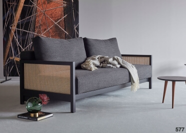 CANAPE TENDANCE AVEC ACCOUDOIRS EN CANNAGE CONVERTIBLE EN COUCHAGE 140X200 - NARVI PAR INNOVATION LIVING